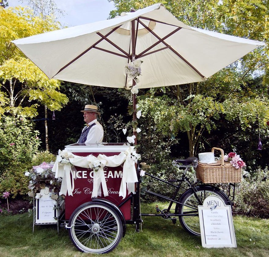 One of our Ice cream bikes. ( Cart, bicycle)
